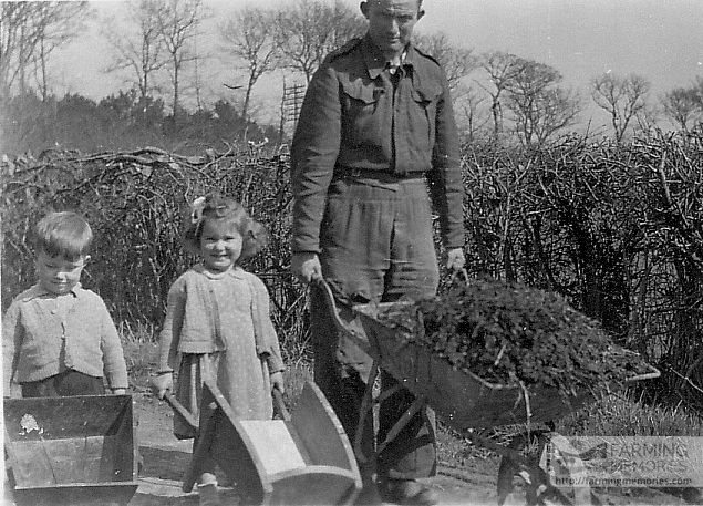 Matthew Comer, Ruth and Robin -Ruth's brother- with wheelbarrows at home Sunny Bay, Forest Road, Newport