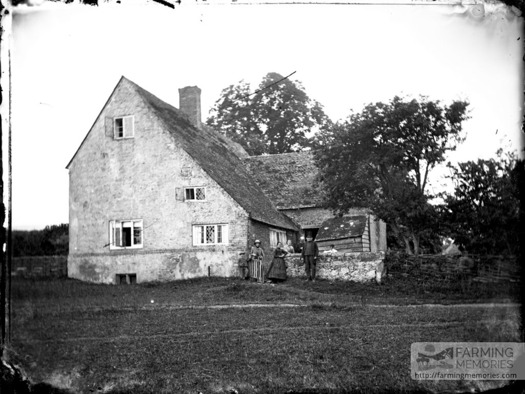 Glass negative of Upper Hyde Farm, Shanklin with six figures at gate