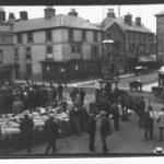 Black and white photograph which shows St James' Square, Newport cattle market before Victoria memorial