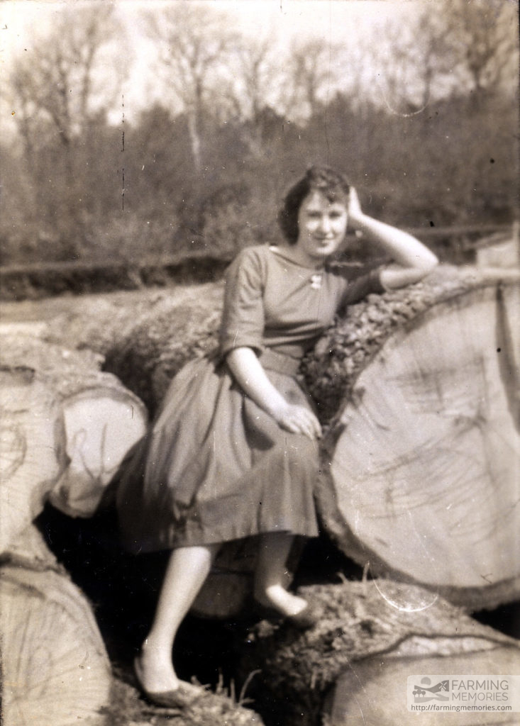 Ruth Stone nee Comer on logs at the sawmill, Forest Road, Newport